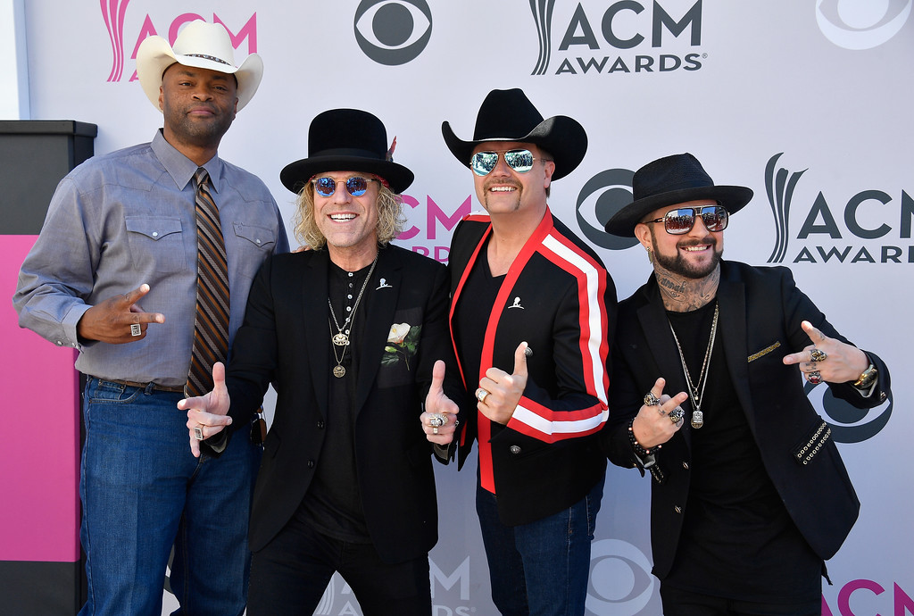 . LAS VEGAS, NV - APRIL 02:  (L-R) Recording artists Cowboy Troy, Big Kenny and John Rich of music group Big & Rich, and DJ Sinister attend the 52nd Academy Of Country Music Awards at Toshiba Plaza on April 2, 2017 in Las Vegas, Nevada.  (Photo by Frazer Harrison/Getty Images)