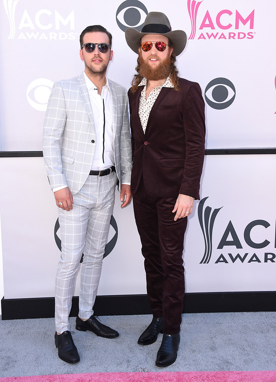 . T.J. Osborne, left, and John Osborne, of Brothers Osborne, arrive at the 52nd annual Academy of Country Music Awards at the T-Mobile Arena on Sunday, April 2, 2017, in Las Vegas. (Photo by Jordan Strauss/Invision/AP)