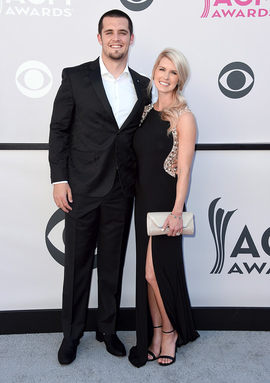 . NFL player Derek Carr, of the Oakland Raiders, left, and Heather Neel arrive at the 52nd annual Academy of Country Music Awards at the T-Mobile Arena on Sunday, April 2, 2017, in Las Vegas. (Photo by Jordan Strauss/Invision/AP)
