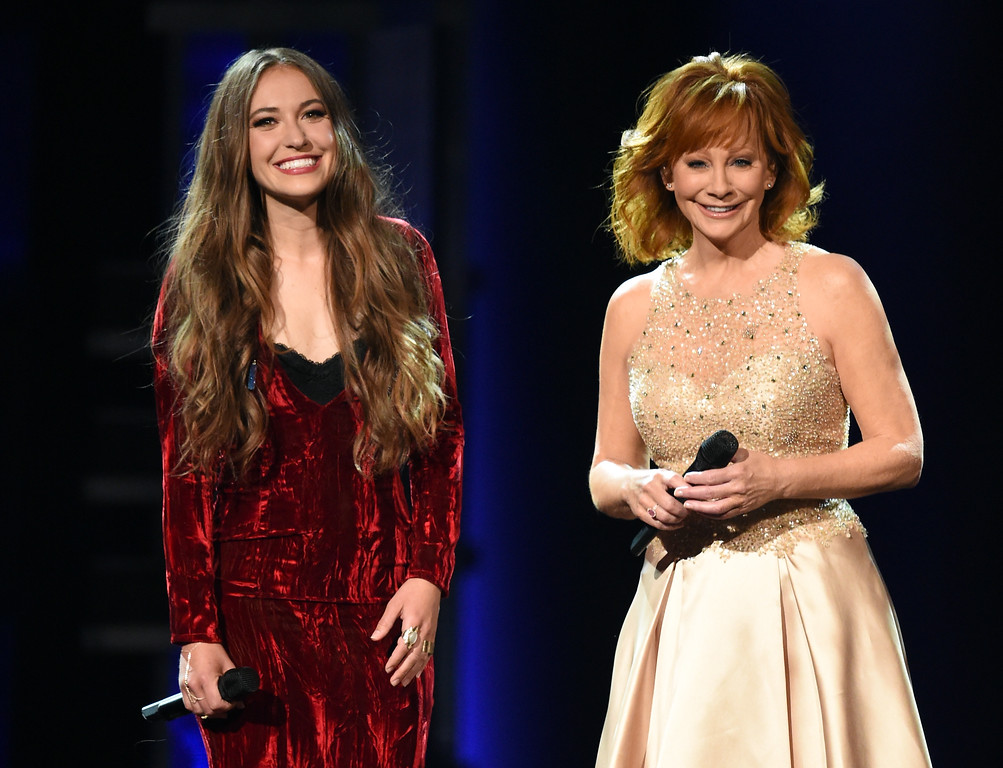 . LAS VEGAS, NV - APRIL 02:  Recording artists Lauren Daigle (L) and Reba McEntire perform onstage during the 52nd Academy Of Country Music Awards at T-Mobile Arena on April 2, 2017 in Las Vegas, Nevada.  (Photo by Ethan Miller/Getty Images)