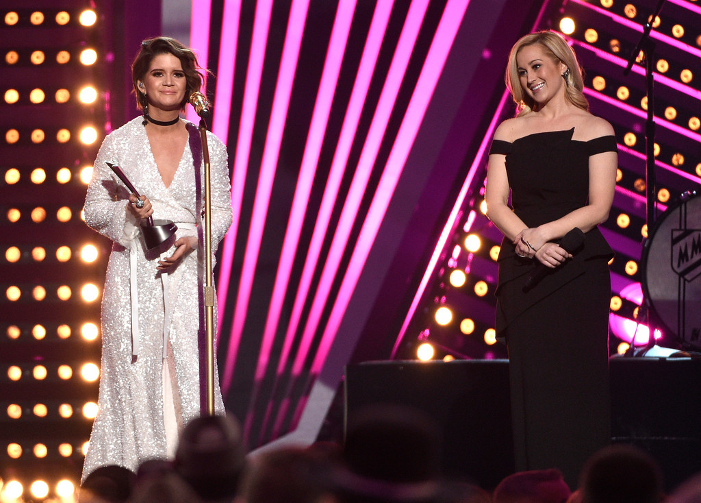 . Maren Morris accepts the award for new female vocalist of the year as presenter Kellie Pickler looks on at right at the 52nd annual Academy of Country Music Awards at the T-Mobile Arena on Sunday, April 2, 2017, in Las Vegas. (Photo by Chris Pizzello/Invision/AP)