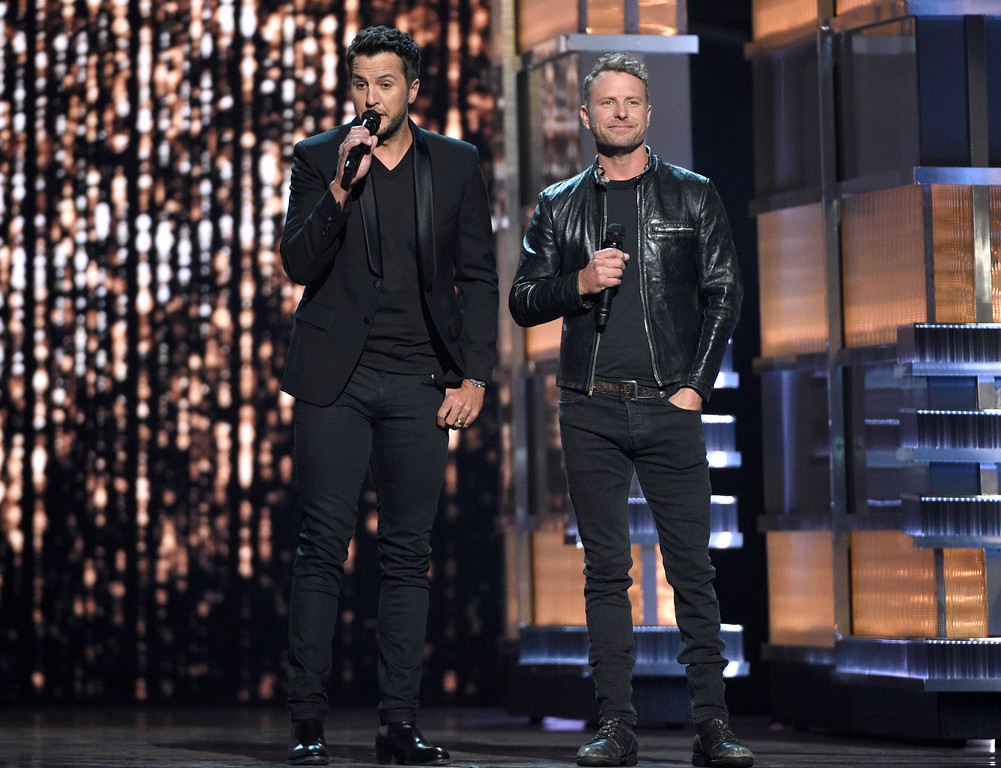 . Hosts Luke Bryan, left, and Dierks Bentley speak at the 52nd annual Academy of Country Music Awards at the T-Mobile Arena on Sunday, April 2, 2017, in Las Vegas. (Photo by Chris Pizzello/Invision/AP)