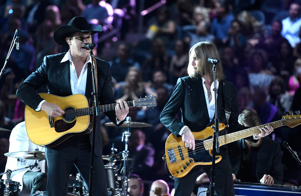 ". Jon Pardi, left, performs ""Dirt on My Boots\"" at the 52nd annual Academy of Country Music Awards at the T-Mobile Arena on Sunday, April 2, 2017, in Las Vegas. (Photo by Chris Pizzello/Invision/AP)"
