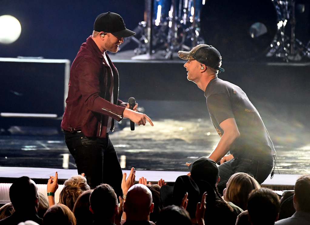 . LAS VEGAS, NV - APRIL 02:  Recording artist Cole Swindell (L) and co-host Dierks Bentley perform onstage during the 52nd Academy Of Country Music Awards at T-Mobile Arena on April 2, 2017 in Las Vegas, Nevada.  (Photo by Ethan Miller/Getty Images)