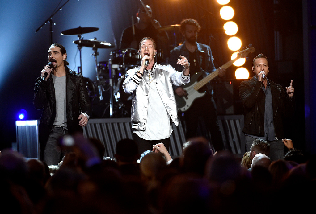 . Tyler Hubbard, center, of Florida Georgia Line, Kevin Richardson, left, and Howie Dorough, right, of Backstreet Boys, perform at the 52nd annual Academy of Country Music Awards at the T-Mobile Arena on Sunday, April 2, 2017, in Las Vegas. (Photo by Chris Pizzello/Invision/AP)