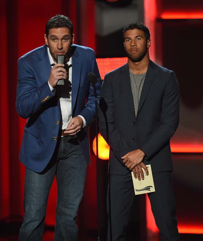 . LAS VEGAS, NV - APRIL 02:  Professional race car drivers Elliott Sadler (L) and Darrell \'Bubba\' Wallace Jr. speak onstage during the 52nd Academy Of Country Music Awards at T-Mobile Arena on April 2, 2017 in Las Vegas, Nevada.  (Photo by Ethan Miller/Getty Images)