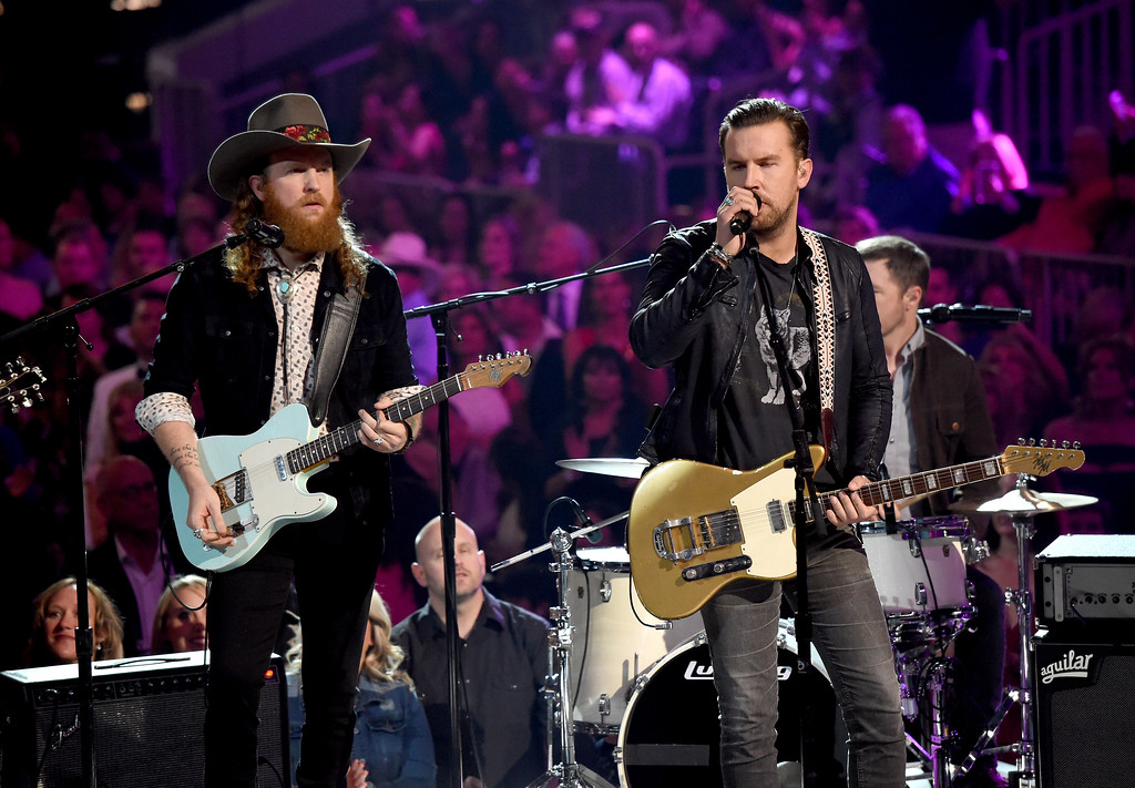 . LAS VEGAS, NV - APRIL 02:  Recording artists John Osborne (L) and T.J. Osborne of music group Brothers Osborne perform onstage during the 52nd Academy Of Country Music Awards at T-Mobile Arena on April 2, 2017 in Las Vegas, Nevada.  (Photo by Ethan Miller/Getty Images)