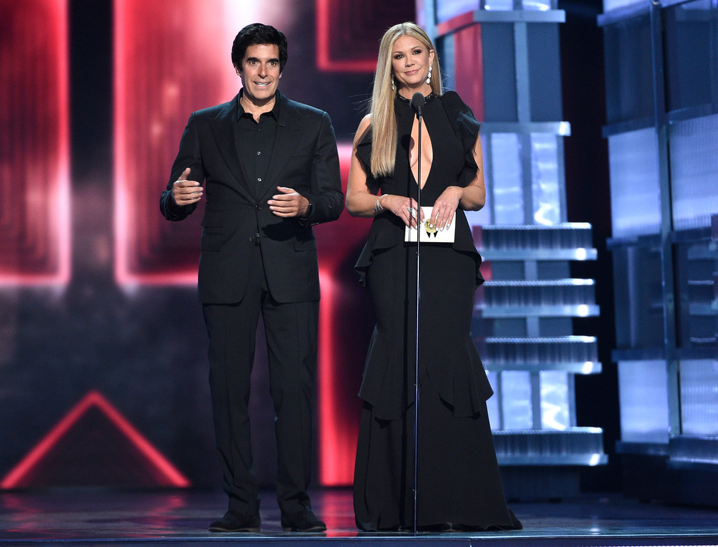 . David Copperfield, left, and Nancy O\'Dell present the award for song of the year at the 52nd annual Academy of Country Music Awards at the T-Mobile Arena on Sunday, April 2, 2017, in Las Vegas. (Photo by Chris Pizzello/Invision/AP)