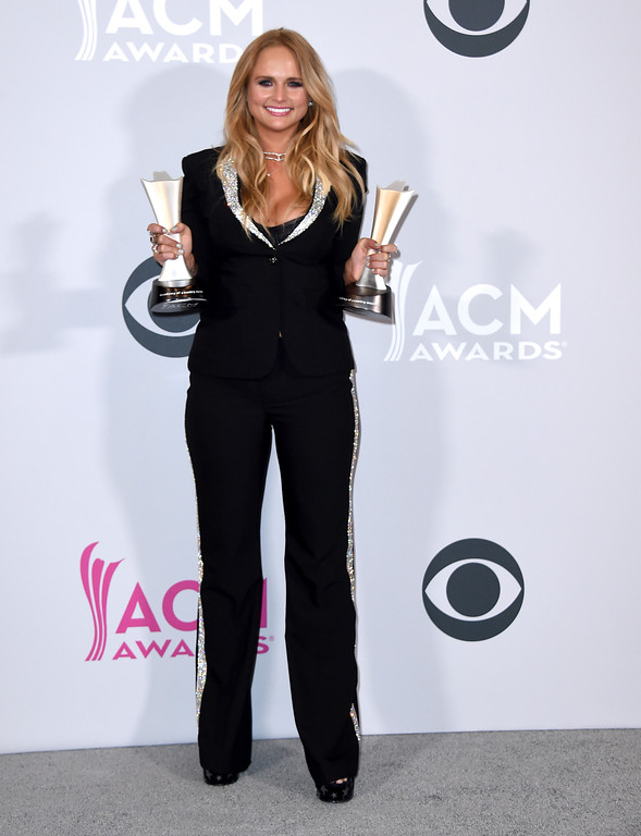 ". Miranda Lambert poses in the press room with her awards for album of the year for ""The Weight of These Wings,\"" and female vocalist of the year at the 52nd annual Academy of Country Music Awards at the T-Mobile Arena on Sunday, April 2, 2017, in Las Vegas. (Photo by Jordan Strauss/Invision/AP)"
