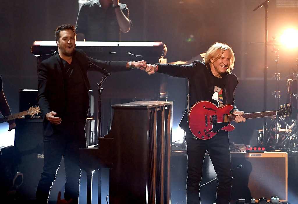 . LAS VEGAS, NV - APRIL 02:  Co-host Luke Bryan (L) and recording artist Joe Walsh perform onstage during the 52nd Academy Of Country Music Awards at T-Mobile Arena on April 2, 2017 in Las Vegas, Nevada.  (Photo by Ethan Miller/Getty Images)