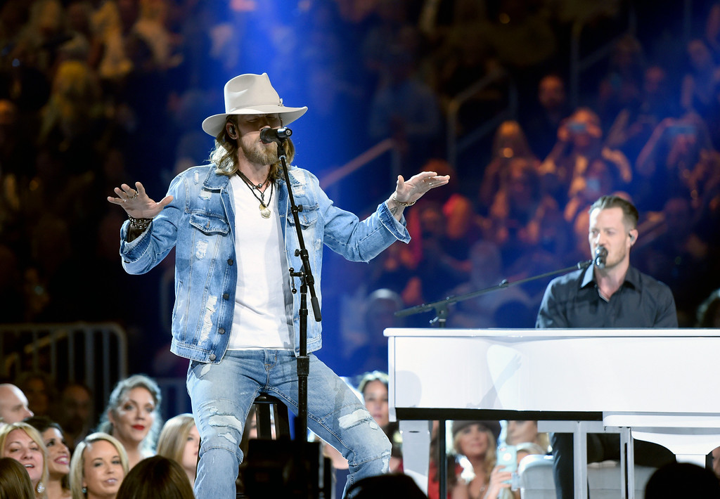 . Brian Kelley, left, and Tyler Hubbard, of Florida Georgia Line, perform at the 52nd annual Academy of Country Music Awards at the T-Mobile Arena on Sunday, April 2, 2017, in Las Vegas. (Photo by Chris Pizzello/Invision/AP)