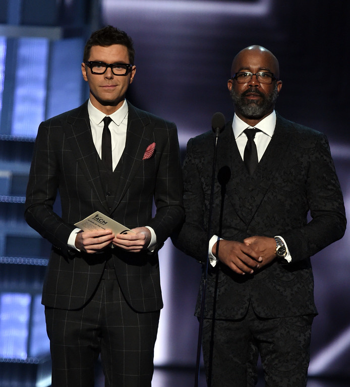 . LAS VEGAS, NV - APRIL 02:  Radio personality Bobby Bones (L) and recording artist Darius Rucker speak onstage during the 52nd Academy Of Country Music Awards at T-Mobile Arena on April 2, 2017 in Las Vegas, Nevada.  (Photo by Ethan Miller/Getty Images)