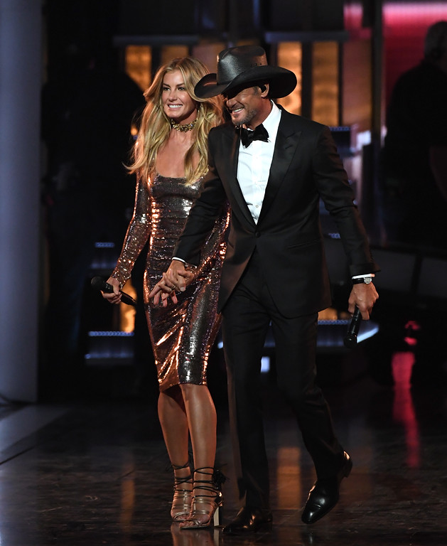 . LAS VEGAS, NV - APRIL 02:  Recording artists Faith Hill (L) and Tim McGraw perform onstage during the 52nd Academy Of Country Music Awards at T-Mobile Arena on April 2, 2017 in Las Vegas, Nevada.  (Photo by Ethan Miller/Getty Images)