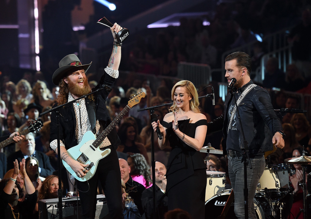 . LAS VEGAS, NV - APRIL 02:  Recording artists John Osborne (L) and T.J. Osborne (R) of music group Brothers Osborne accept the New Vocal Duo or Group Of The Year award presented by T-Mobile from recording artist Kellie Pickler (C) onstage during the 52nd Academy Of Country Music Awards at T-Mobile Arena on April 2, 2017 in Las Vegas, Nevada.  (Photo by Ethan Miller/Getty Images)