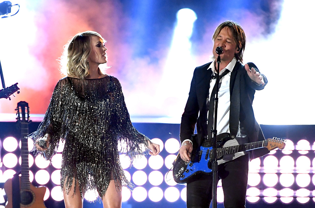 . LAS VEGAS, NV - APRIL 02:  Recording artists Carrie Underwood (L) and Keith Urban perform onstage during the 52nd Academy Of Country Music Awards at T-Mobile Arena on April 2, 2017 in Las Vegas, Nevada.  (Photo by Ethan Miller/Getty Images)