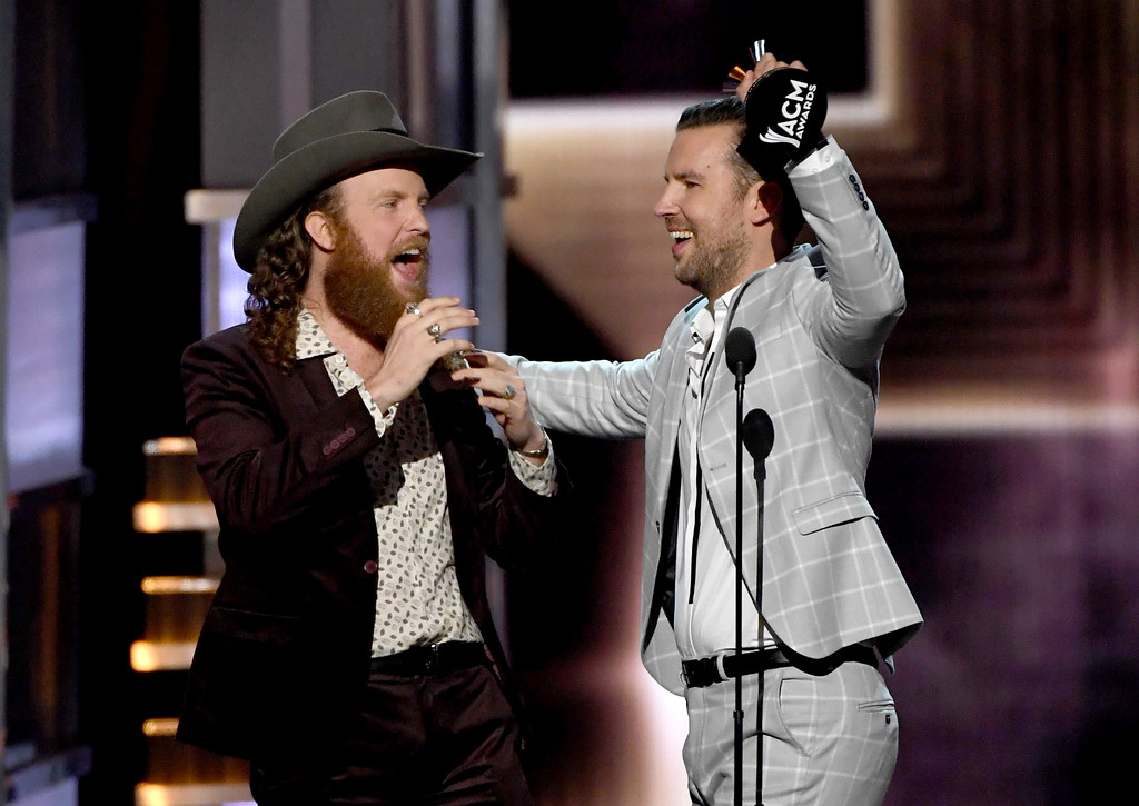 . LAS VEGAS, NV - APRIL 02:  Recording artists John Osborne (L) and T.J. Osborne of music group Brothers Osborne accept the Vocal Duo of the Year award onstage during the 52nd Academy Of Country Music Awards at T-Mobile Arena on April 2, 2017 in Las Vegas, Nevada.  (Photo by Ethan Miller/Getty Images)