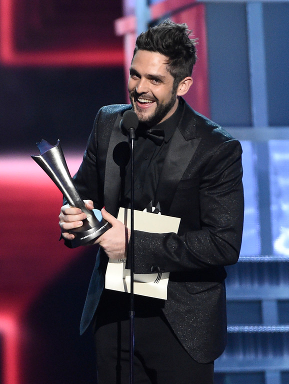 ". Thomas Rhett accepts the award for song of the year for ""Die A Happy Man\"" at the 52nd annual Academy of Country Music Awards at the T-Mobile Arena on Sunday, April 2, 2017, in Las Vegas. (Photo by Chris Pizzello/Invision/AP)"