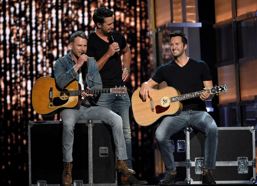 . Dierks Bentley, left, and Luke Bryan, center, appear on stage with a wax figure of Bryan at the 52nd annual Academy of Country Music Awards at the T-Mobile Arena on Sunday, April 2, 2017, in Las Vegas. (Photo by Chris Pizzello/Invision/AP)