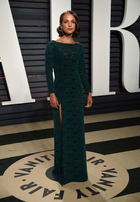 . Alicia Vikander arrives at the Vanity Fair Oscar Party on Monday, Feb. 27, 2017, in Beverly Hills, Calif. (Photo by Evan Agostini/Invision/AP)