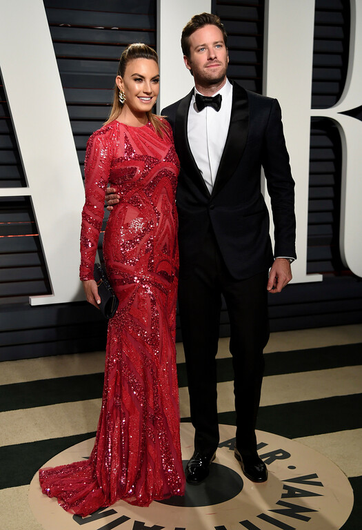 . Elizabeth Chambers, left, and Armie Hammer arrive at the Vanity Fair Oscar Party on Sunday, Feb. 26, 2017, in Beverly Hills, Calif. (Photo by Evan Agostini/Invision/AP)