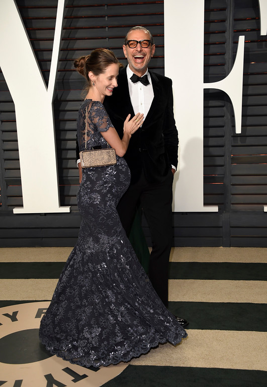. Emilie Livingston, left, and Jeff Goldblum arrive at the Vanity Fair Oscar Party on Sunday, Feb. 26, 2017, in Beverly Hills, Calif. (Photo by Evan Agostini/Invision/AP)