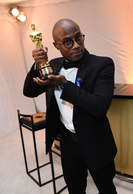 """. Barry Jenkins poses with the award for best adapted screenplay for \""""Moonlight\"""" at the Governors Ball after the Oscars on Sunday, Feb. 26, 2017, at the Dolby Theatre in Los Angeles. (Photo by Al Powers/Invision/AP)"""
