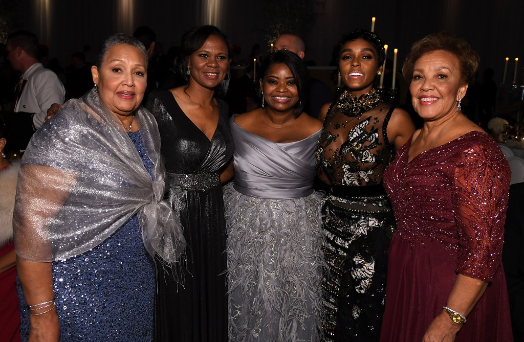 """. Nominee for Best Supporting Actress \""""Hidden Figures\"""" Octavia Spencer (C) and musician Janelle Monae (2nd R) pose with guests at the 89h Annual Academy Awards Governors Ball in Hollywood, California, on February 26, 2017. (ANGELA WEISS/AFP/Getty Images)"""