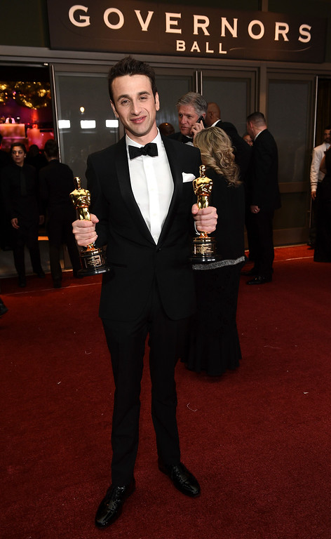 """. Justin Hurwitz, winner of the award for best original score for \""""La La Land\"""" and best original song for \""""City of Stars\"""" from \""""La La Land,\"""" attends the Governors Ball after the Oscars on Sunday, Feb. 26, 2017, at the Dolby Theatre in Los Angeles. (Photo by Al Powers/Invision/AP)"""