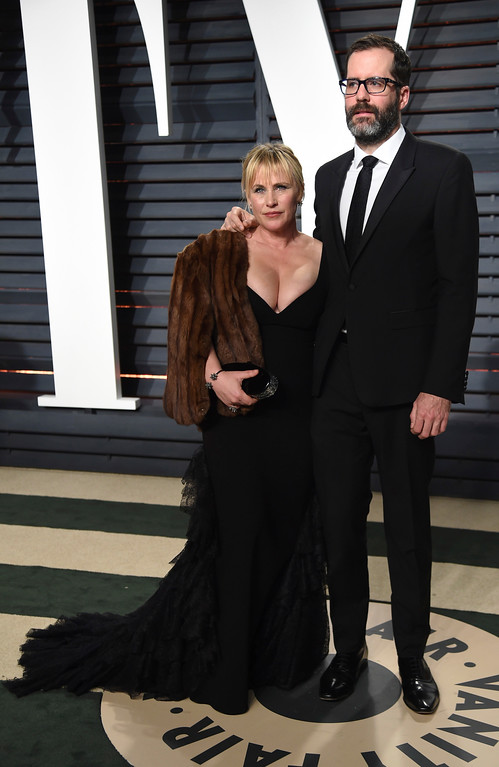 . Patricia Arquette, left, and Eric White arrive at the Vanity Fair Oscar Party on Sunday, Feb. 26, 2017, in Beverly Hills, Calif. (Photo by Evan Agostini/Invision/AP)