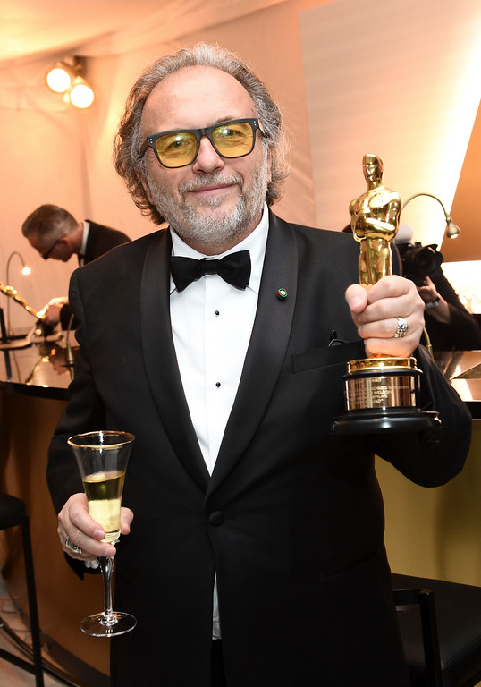 """. Alessandro Bertolazzi poses with his award for best makeup and hairstyling for \""""Suicide Squad\"""" at the Governors Ball after the Oscars on Sunday, Feb. 26, 2017, at the Dolby Theatre in Los Angeles. (Photo by Al Powers/Invision/AP)"""