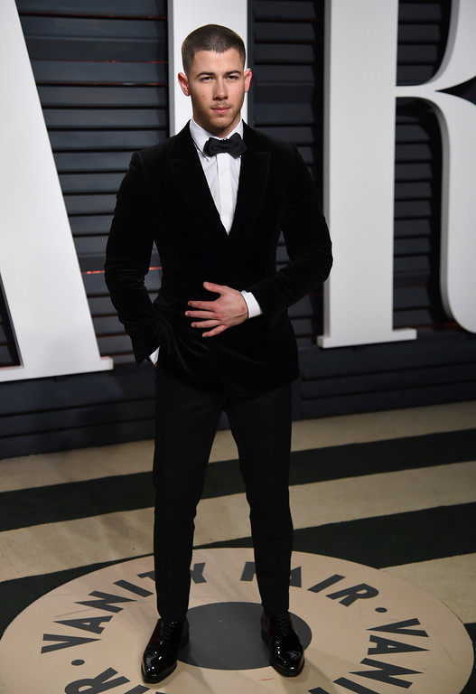 . Nick Jonas arrives at the Vanity Fair Oscar Party on Sunday, Feb. 26, 2017, in Beverly Hills, Calif. (Photo by Evan Agostini/Invision/AP)