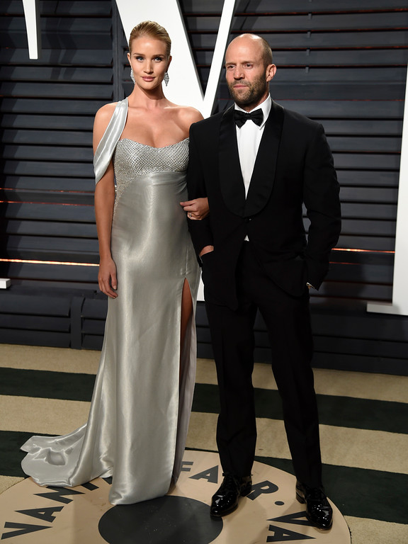 . Rosie Huntington-Whiteley, left, and Jason Statham arrive at the Vanity Fair Oscar Party on Sunday, Feb. 26, 2017, in Beverly Hills, Calif. (Photo by Evan Agostini/Invision/AP)