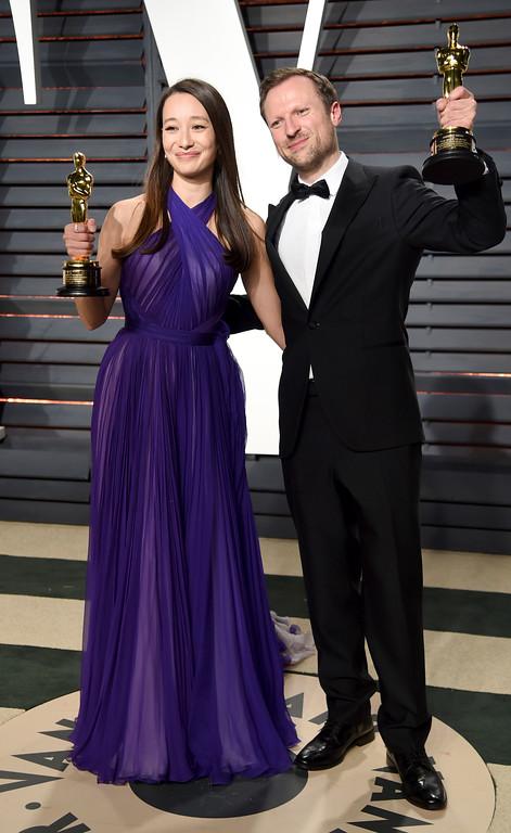 . Joanna Natasegara and Orlando von Einsiedel arrive at the Vanity Fair Oscar Party on Monday, Feb. 27, 2017, in Beverly Hills, Calif. (Photo by Evan Agostini/Invision/AP)