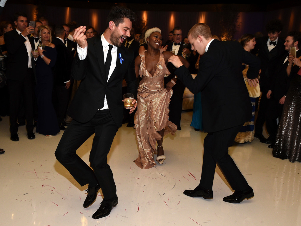 . Dominic Cooper, from left, Cynthia Erivo and Lucas Hedges dance at the Governors Ball after the Oscars on Sunday, Feb. 26, 2017, at the Dolby Theatre in Los Angeles. (Photo by Al Powers/Invision/AP)