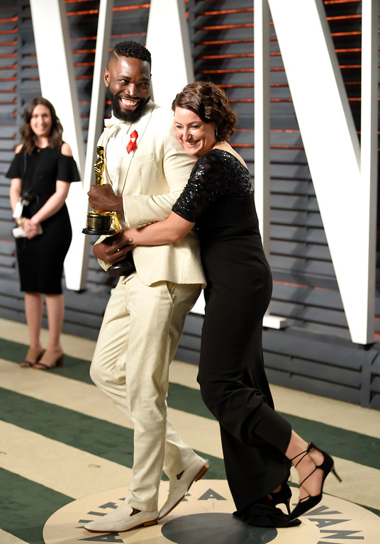 . Tarell Alvin McCraney, left, and Adele Romanski arrives at the Vanity Fair Oscar Party on Monday, Feb. 27, 2017, in Beverly Hills, Calif. (Photo by Evan Agostini/Invision/AP)