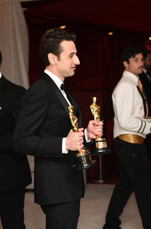 """. Justin Hurwitz poses with the awards for best original score for \""""La La Land\"""" and best original song for \""""City of Stars\"""" at the Governors Ball after the Oscars on Sunday, Feb. 26, 2017, at the Dolby Theatre in Los Angeles. (Photo by Al Powers/Invision/AP)"""