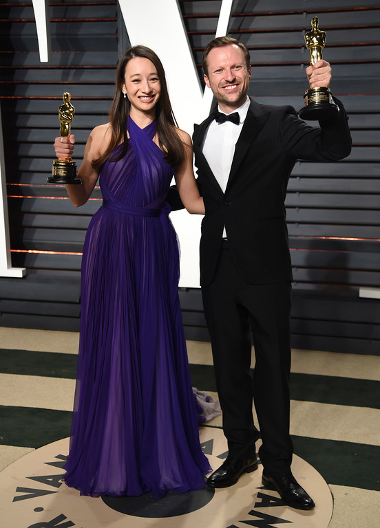 . Joanna Natasegara, left, and Orlando von Einsiedel arrive at the Vanity Fair Oscar Party on Monday, Feb. 27, 2017, in Beverly Hills, Calif. (Photo by Evan Agostini/Invision/AP)