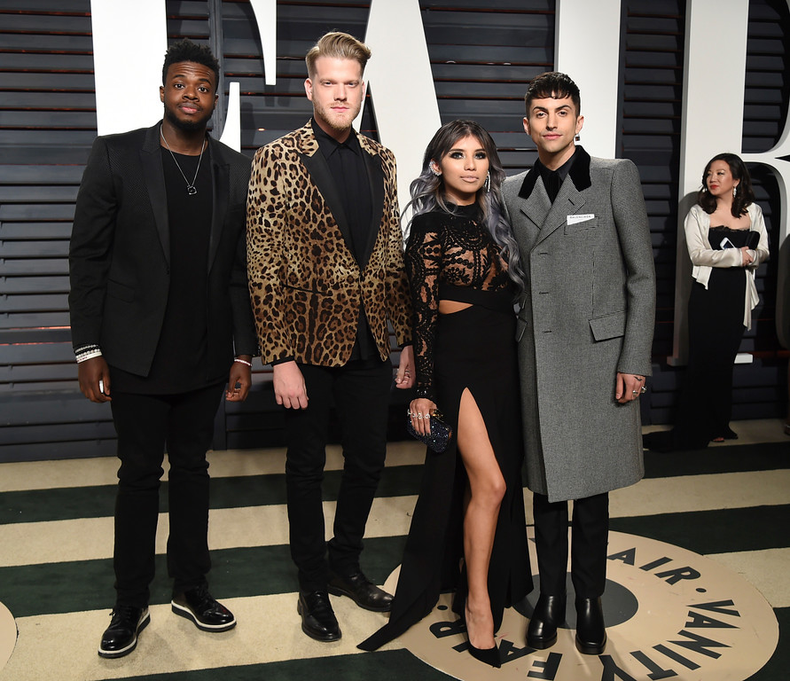 . Pentatonix members, from left, Kevin Olusola, Scott Hoying, Kirstin Maldonado, and Mitch Grassi arrive at the Vanity Fair Oscar Party on Monday, Feb. 27, 2017, in Beverly Hills, Calif. (Photo by Evan Agostini/Invision/AP)