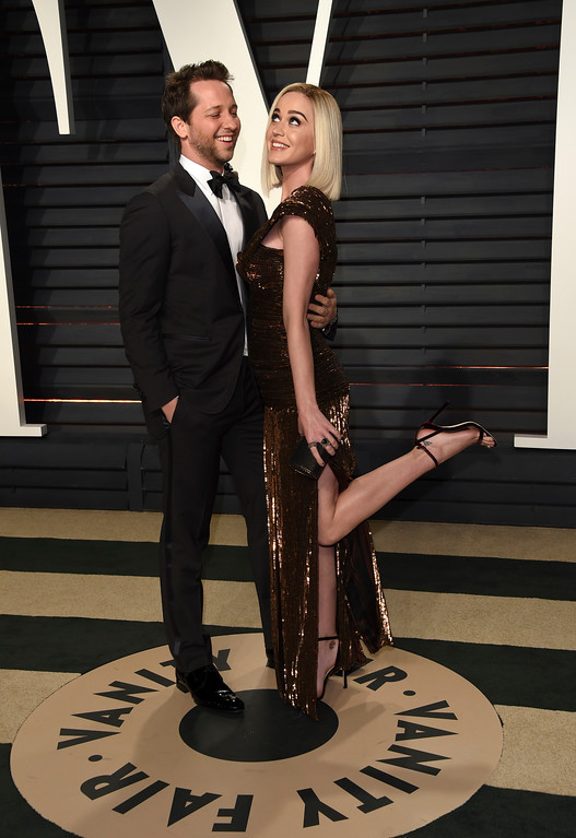 . Derek Blasberg, left, and Katy Perry arrive at the Vanity Fair Oscar Party on Sunday, Feb. 26, 2017, in Beverly Hills, Calif. (Photo by Evan Agostini/Invision/AP)