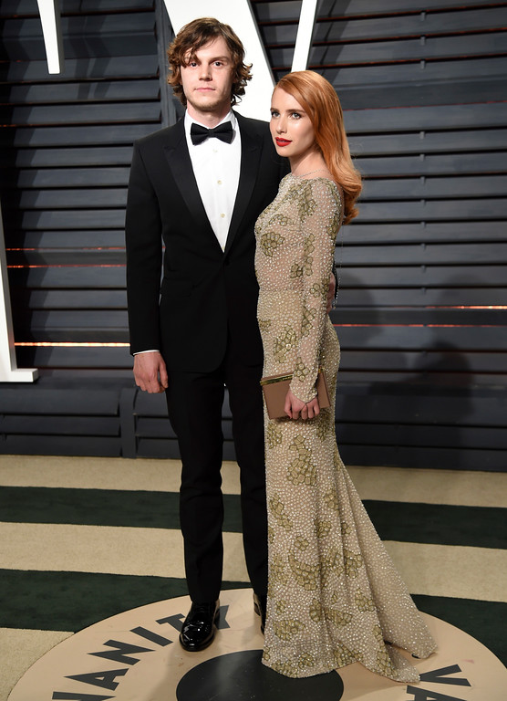 . Evan Peters, left, and Emma Roberts arrive at the Vanity Fair Oscar Party on Sunday, Feb. 26, 2017, in Beverly Hills, Calif. (Photo by Evan Agostini/Invision/AP)