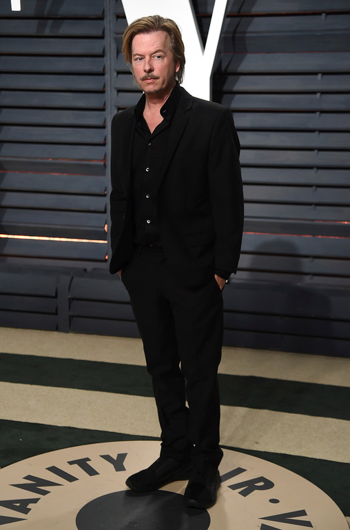 . David Spade arrives at the Vanity Fair Oscar Party on Sunday, Feb. 26, 2017, in Beverly Hills, Calif. (Photo by Evan Agostini/Invision/AP)