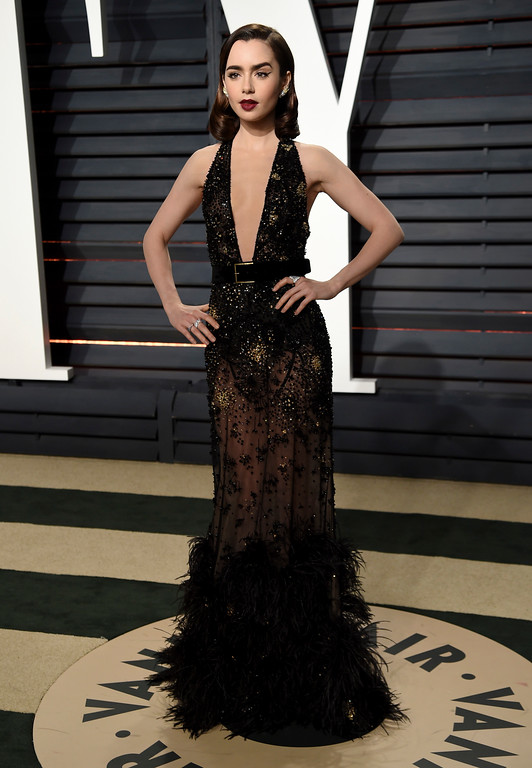. Lily Collins arrives at the Vanity Fair Oscar Party on Sunday, Feb. 26, 2017, in Beverly Hills, Calif. (Photo by Evan Agostini/Invision/AP)