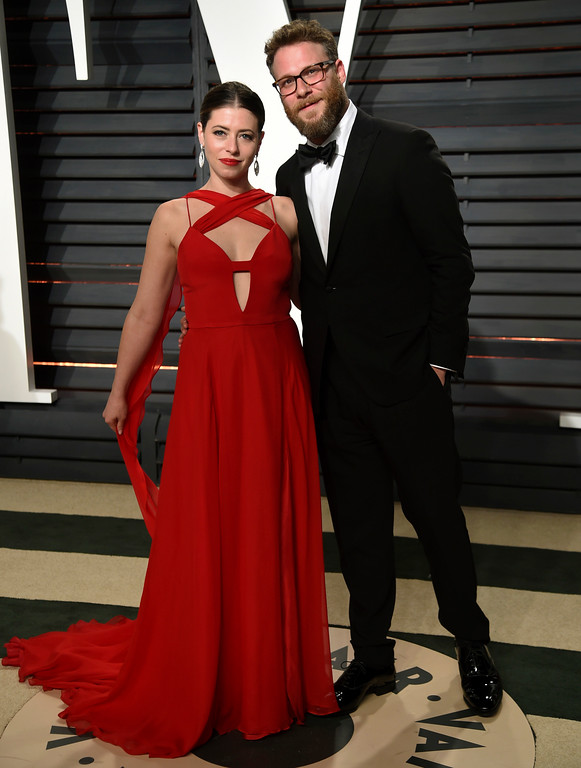 . Lauren Miller, left, and Seth Rogen arrive at the Vanity Fair Oscar Party on Sunday, Feb. 26, 2017, in Beverly Hills, Calif. (Photo by Evan Agostini/Invision/AP)