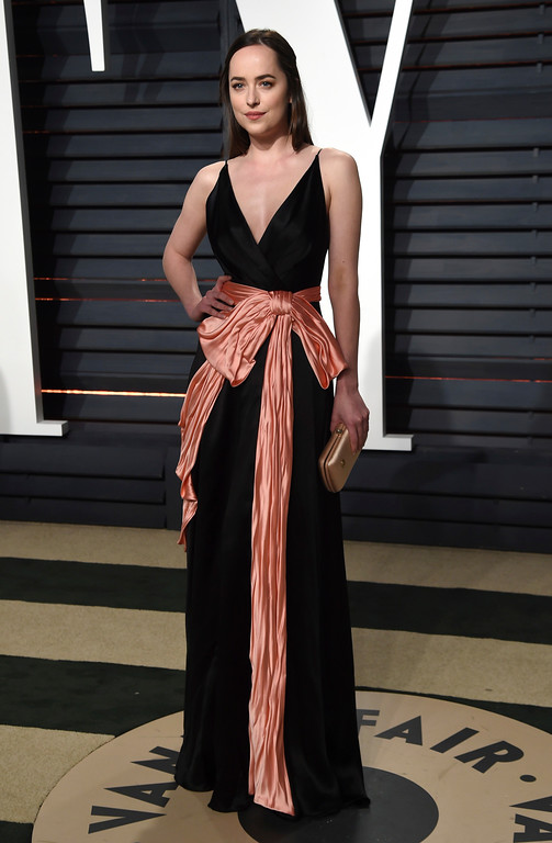. Dakota Johnson arrives at the Vanity Fair Oscar Party on Sunday, Feb. 26, 2017, in Beverly Hills, Calif. (Photo by Evan Agostini/Invision/AP)