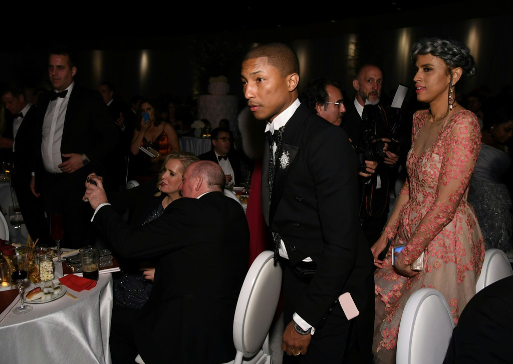 . Pharrell Williams and his wife arrive at the 89h Annual Academy Awards Governors Ball in Hollywood, California, on February 26, 2017. (ANGELA WEISS/AFP/Getty Images)