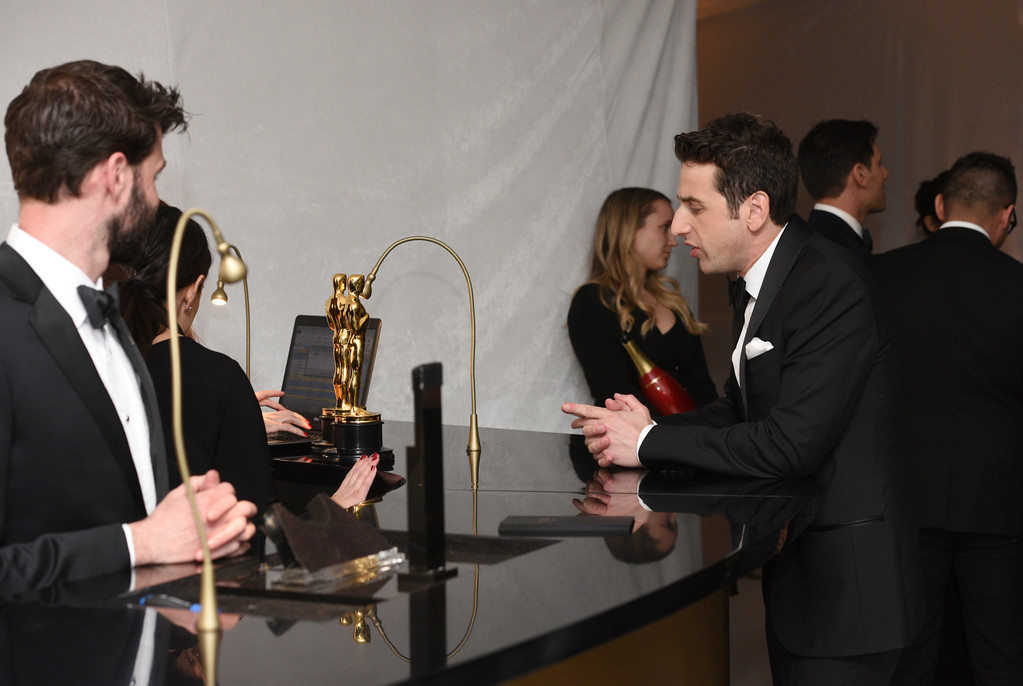 """. Justin Hurwitz waits at the engraving station with the awards for best original score for \""""La La Land\"""" and best original song for \""""City of Stars\"""" at the Governors Ball after the Oscars on Sunday, Feb. 26, 2017, at the Dolby Theatre in Los Angeles. (Photo by Al Powers/Invision/AP)"""