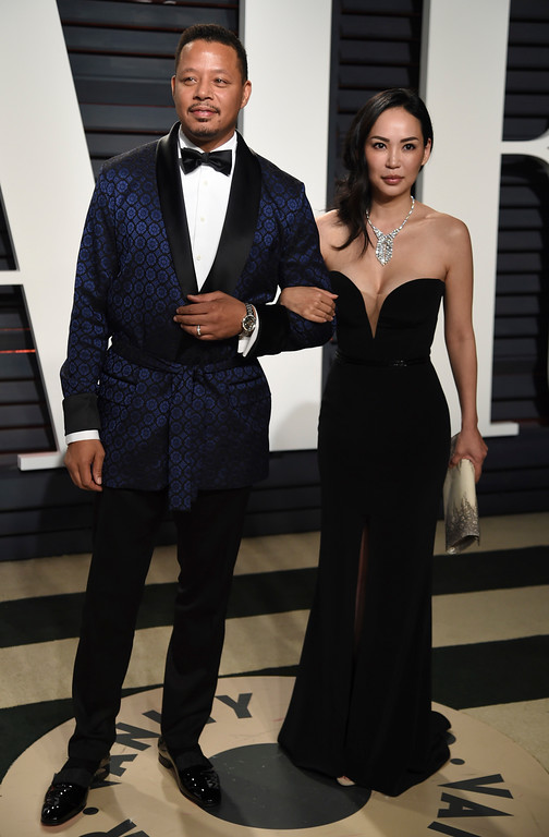 . Terrence Howard, left, and Miranda Pak arrive at the Vanity Fair Oscar Party on Monday, Feb. 27, 2017, in Beverly Hills, Calif. (Photo by Evan Agostini/Invision/AP)