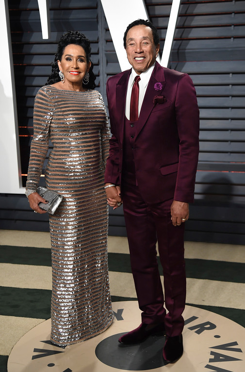 . Frances Glandney, left, and Smokey Robinson arrive at the Vanity Fair Oscar Party on Sunday, Feb. 26, 2017, in Beverly Hills, Calif. (Photo by Evan Agostini/Invision/AP)