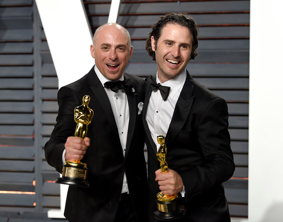. Marc Sondheimer, left, and Alan Barillaro arrive at the Vanity Fair Oscar Party on Monday, Feb. 27, 2017, in Beverly Hills, Calif. (Photo by Evan Agostini/Invision/AP)