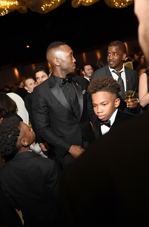 . Alex R. Hibbert, from left, Mahershala Ali and Jaden Piner attend the Governors Ball after the Oscars on Sunday, Feb. 26, 2017, at the Dolby Theatre in Los Angeles. (Photo by Al Powers/Invision/AP)